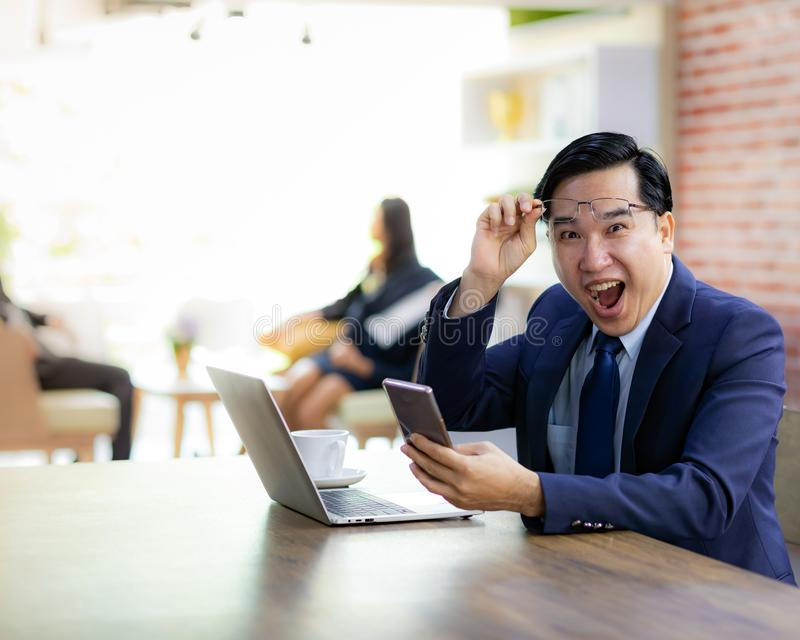 Asian Businessman celebrate in cafe royalty free stock photo