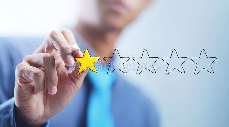 Asian Businessman Drawing 1 out of 5 Stars. Bad Review Concept royalty free stock images