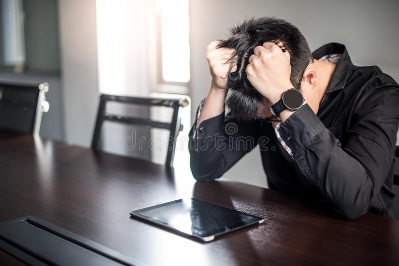 Asian Businessman feeling stressed in meeting room stock images