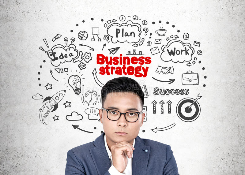 Asian businessman in glasses, strategy royalty free stock image