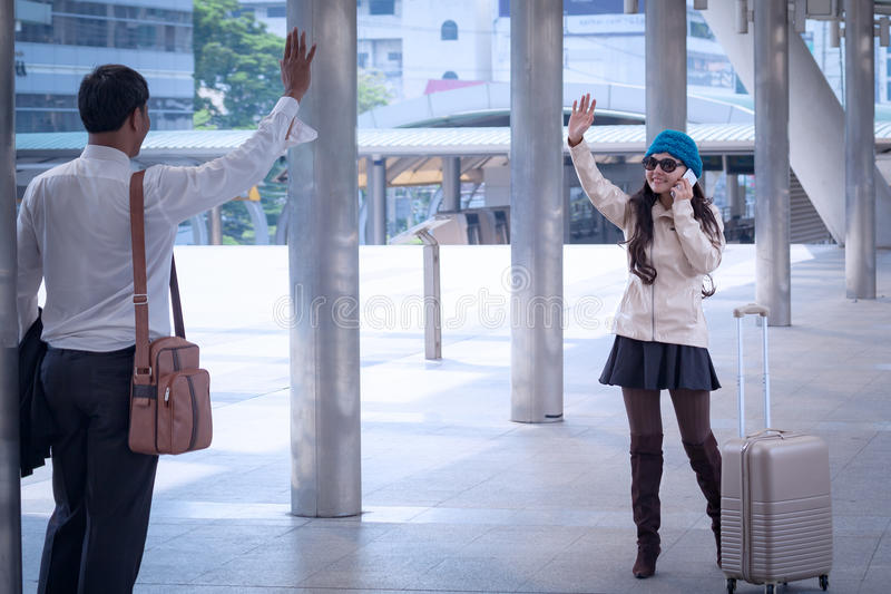 asian businessman Handshake and Greeting with travel women wearing sweater coat and yarn hat for make deal business together, bus royalty free stock photos
