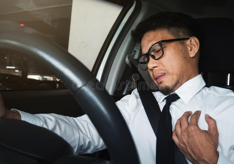Asian businessman having heart attack royalty free stock photo