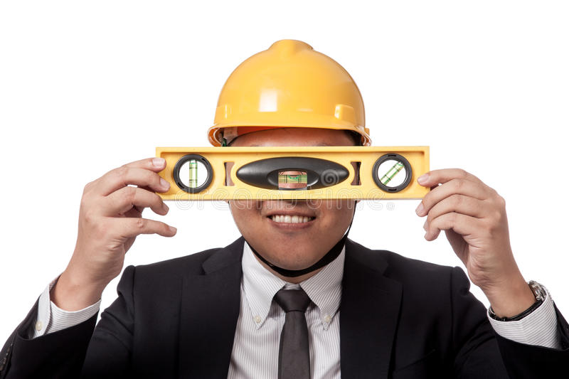 Asian businessman hold a spirit level in front of royalty free stock images