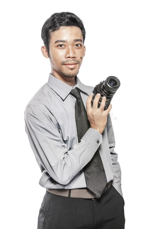 Asian businessman holding the camera on his hand standing stock images