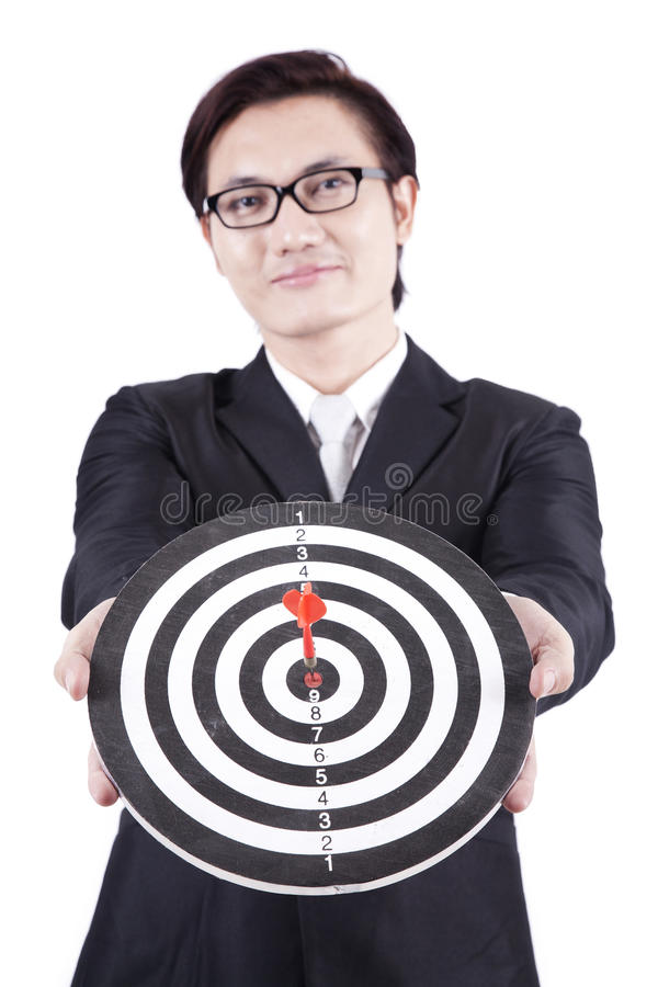 Asian businessman holding dartboard royalty free stock images