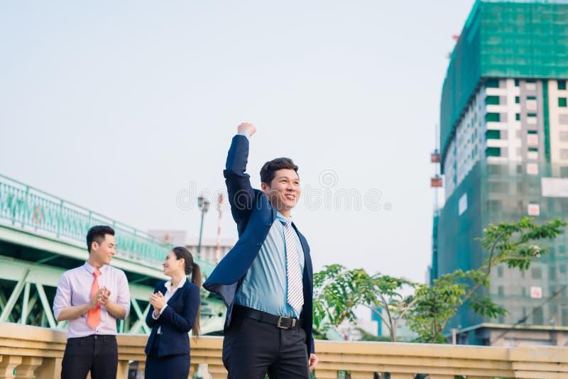 Asian businessman and an interracial group of business men & women, businessmen and businesswomen team royalty free stock photos