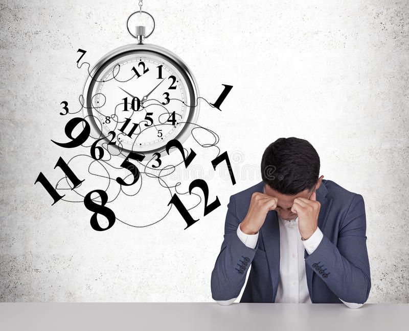 Asian businessman intimidated by time royalty free stock photography