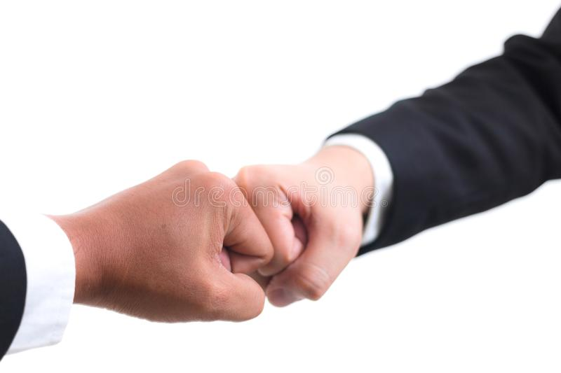 Asian businessman making a fist bump on white background. Close up of young asian businessman making a fist bump on white background. Business people wear suit stock photo