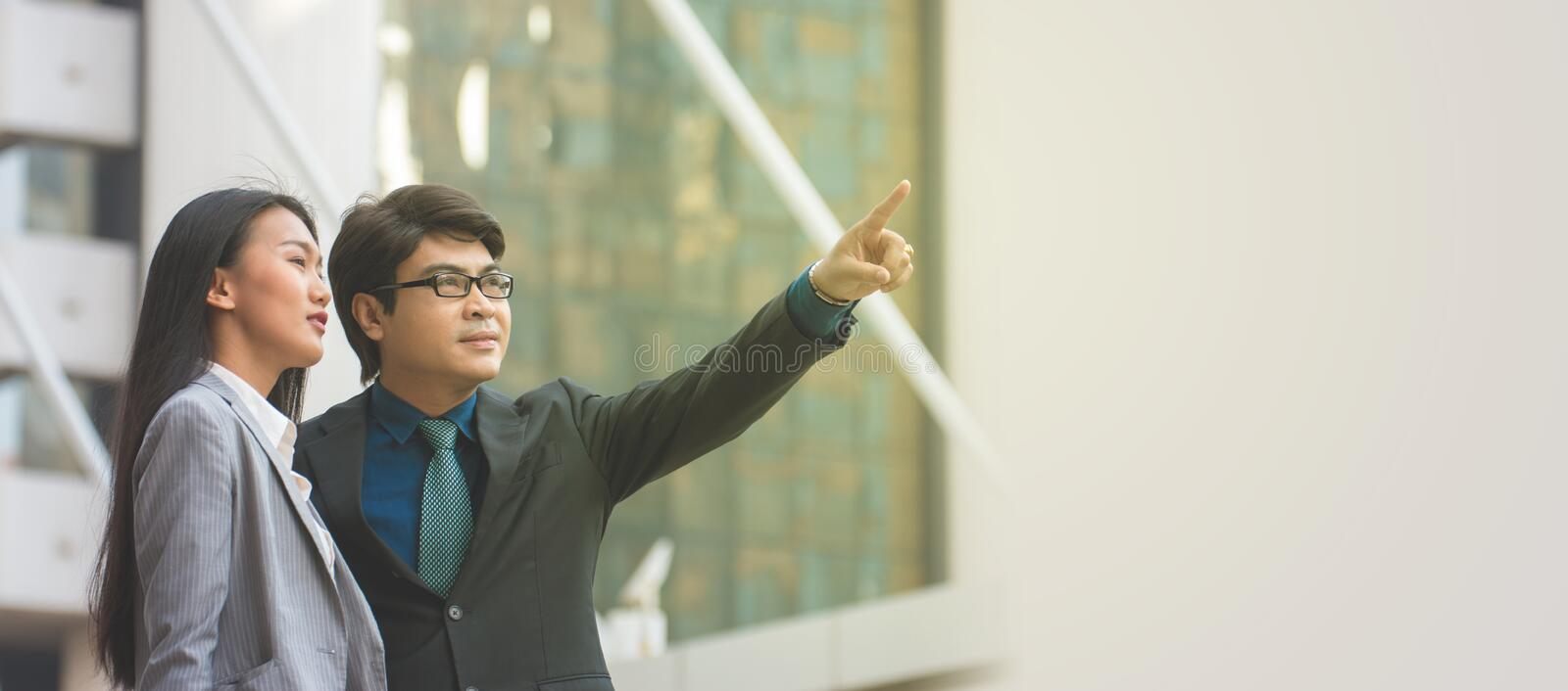 Asian businessman pointing at something stock image