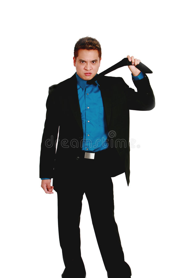 Asian businessman pulling tie royalty free stock photography