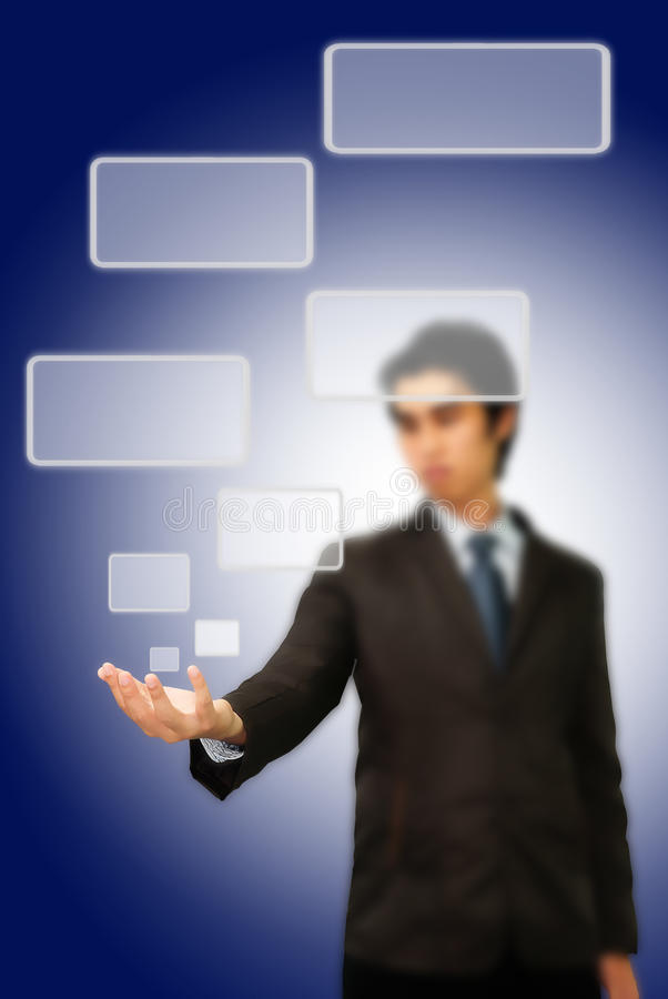 Asian businessman pushing button on the whiteboard stock photo