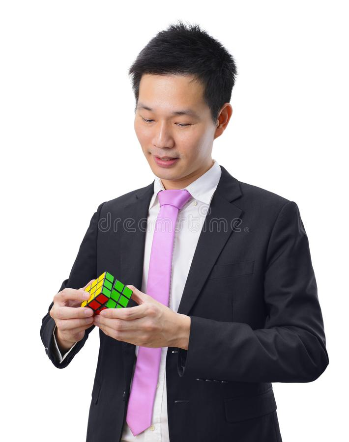 Asian businessman with a puzzle game on white background stock images