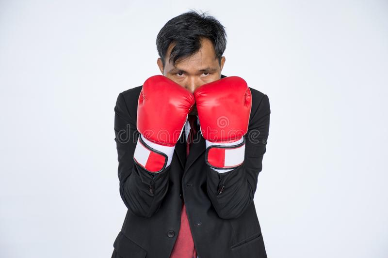 Asian businessman with red boxing glove on white background royalty free stock photography