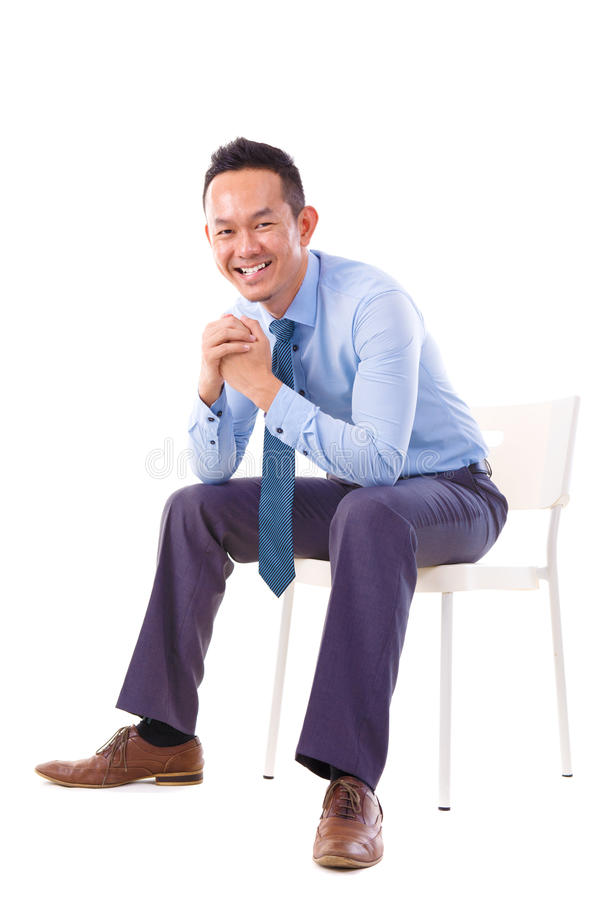 Download Asian Businessman Sitting On A Chair Stock Photo - Image: 26871196