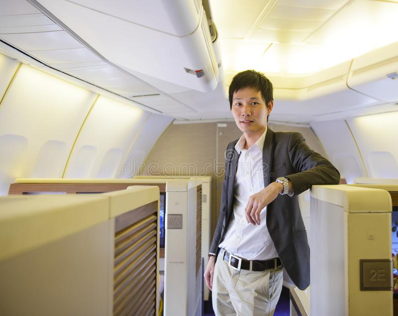 Asian businessman stand on first class cabin.  royalty free stock photography