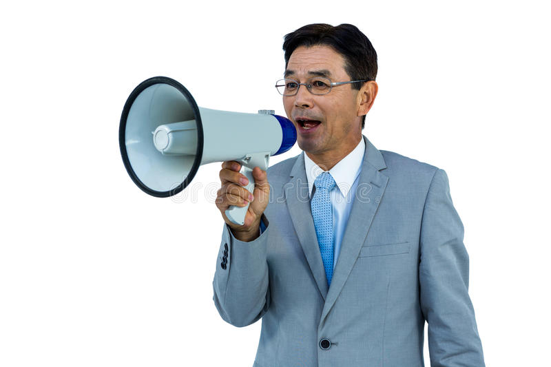 Asian businessman talking through megaphone. On withe background royalty free stock photos