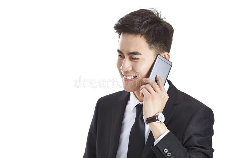 Asian businessman talking on mobile phone stock photo