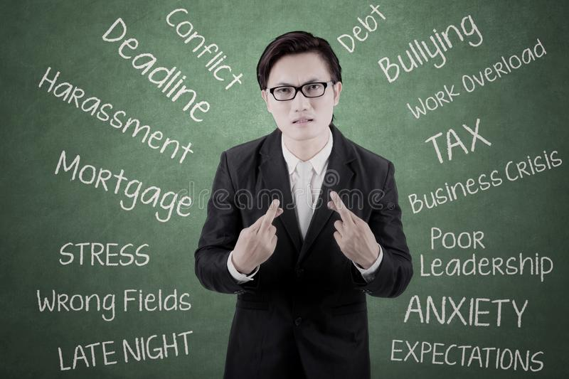 Asian businessman wishing a get lucky stock image