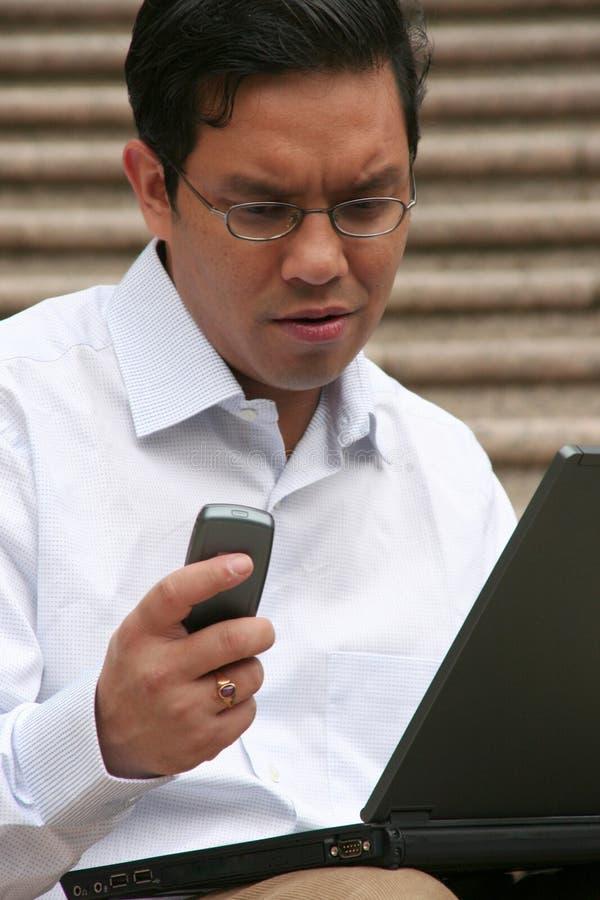 Asian businessman working on laptop royalty free stock image