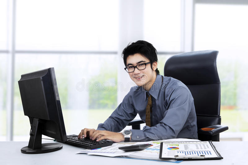 Asian businessman working at office 1 stock photo