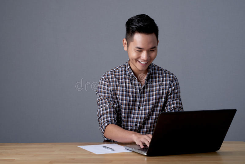 Asian Businessman Wrapped up in Work royalty free stock image