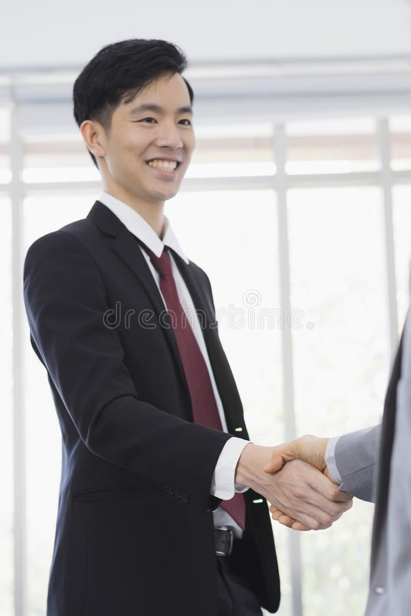 Asian Businessmen handshake together in office royalty free stock photo