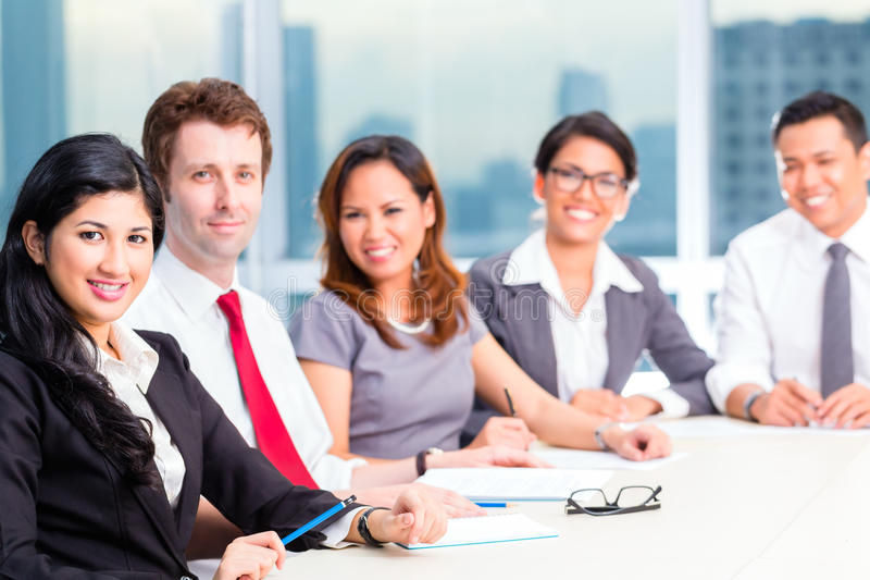 Asian Businesspeople having meeting in office royalty free stock image