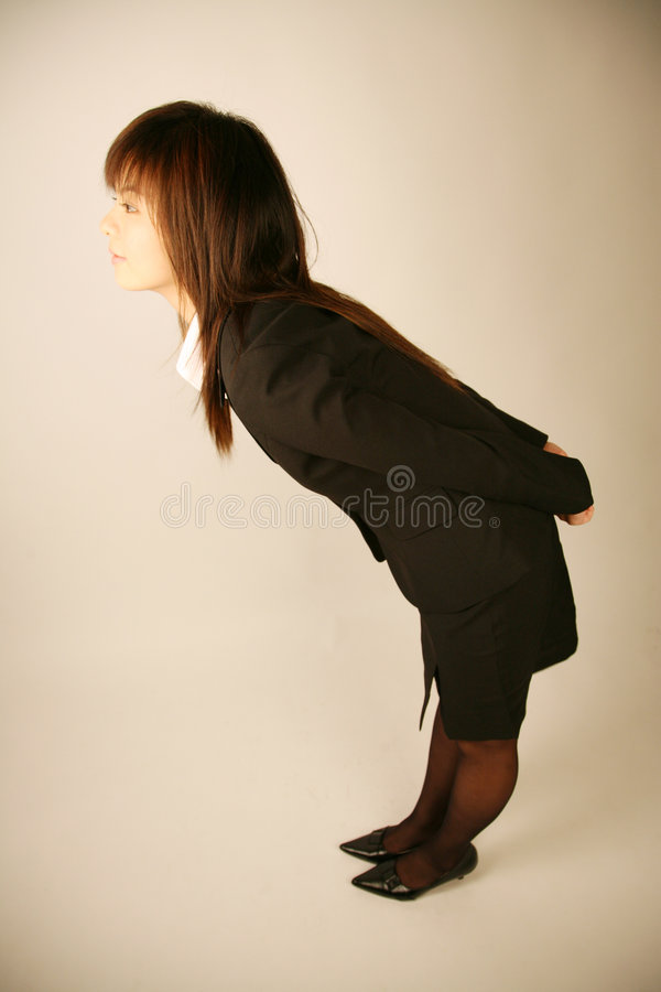 Asian businesswoman bowing. To show respect stock image