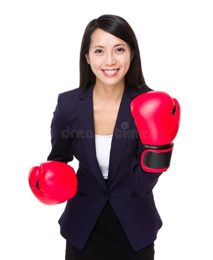 Asian businesswoman with boxing gloves for cheerup gesture. Isolated on white background stock photos