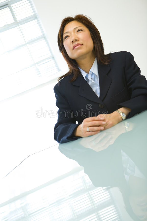 Asian businesswoman at desk stock photo
