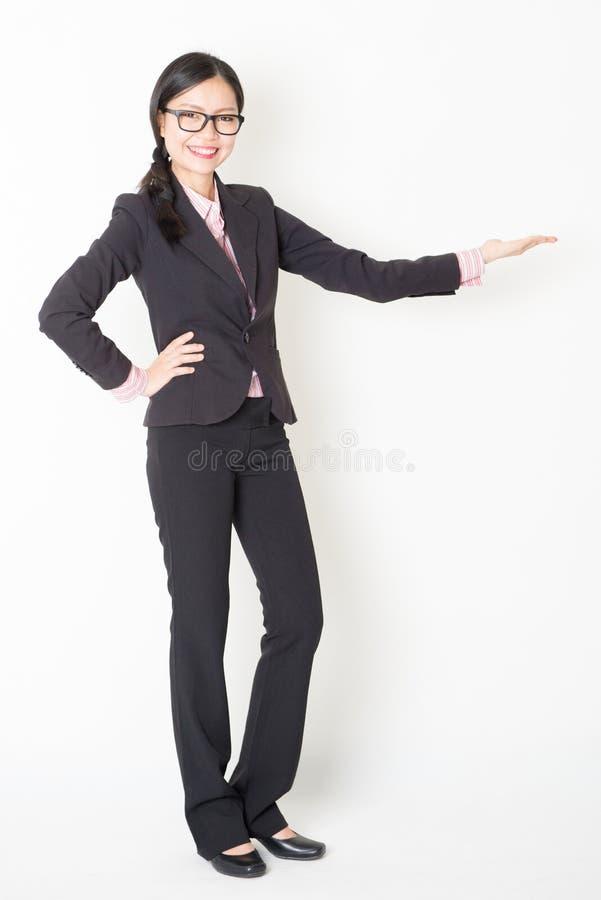 Asian businesswoman displaying something royalty free stock photo
