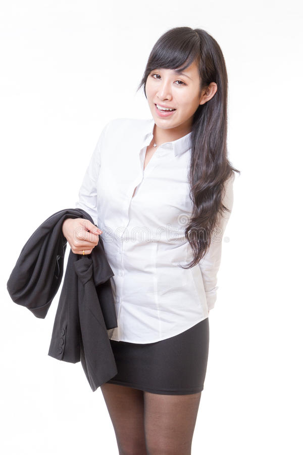 Asian businesswoman holding jacket over arm and laughing royalty free stock images