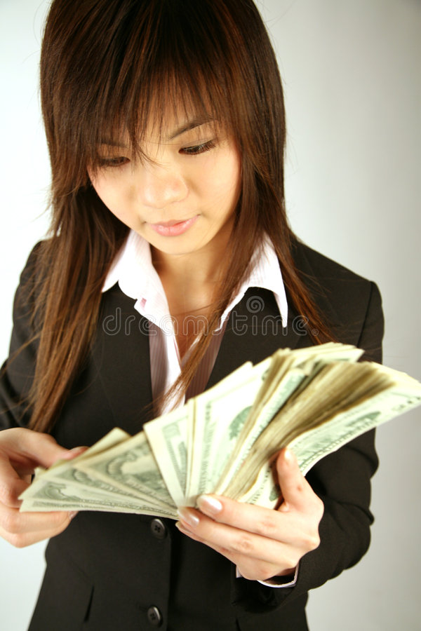 Asian businesswoman with money stock images