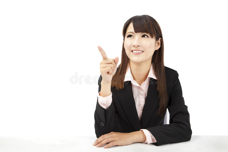 Asian businesswoman pointing. Beautiful asian businesswoman pointing something stock images