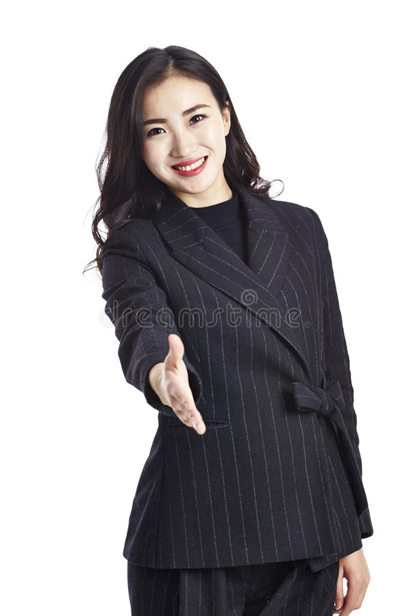 Asian businesswoman reaching out for handshake stock photos