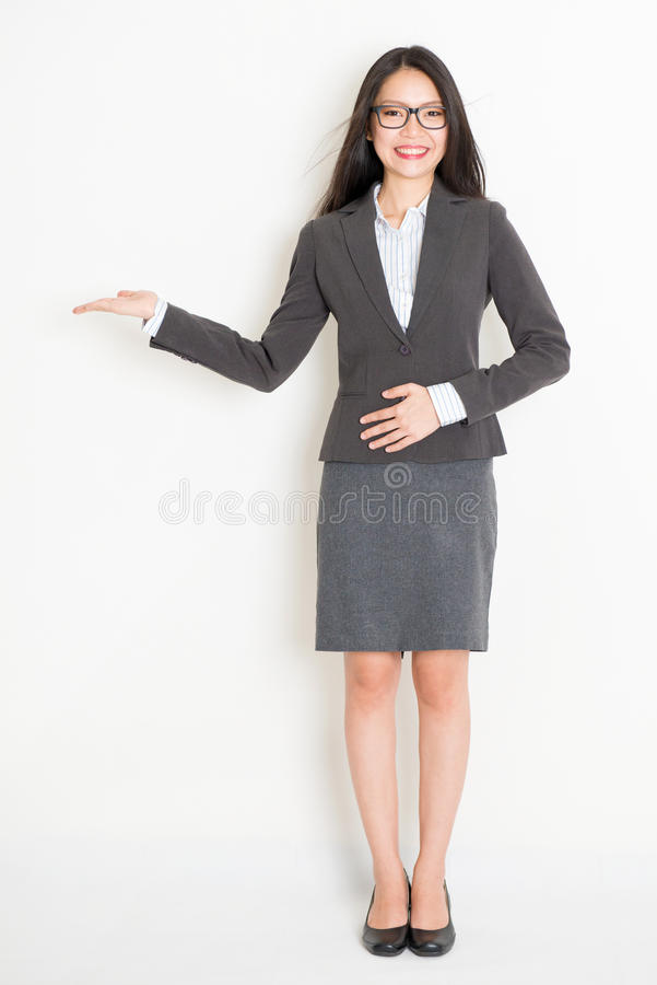 Asian businesswoman showing something royalty free stock images