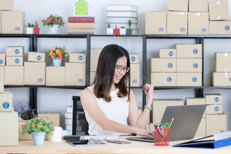 Asian businesswoman smiling and happy Successfully received orders from online customers in the homeoffice. Concept for home base royalty free stock images