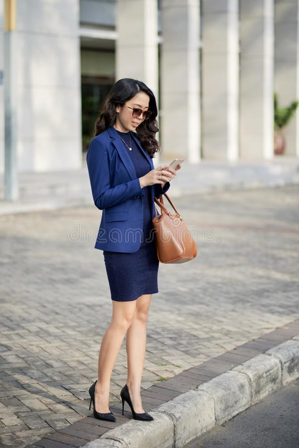 Asian businesswoman standing in the city royalty free stock image