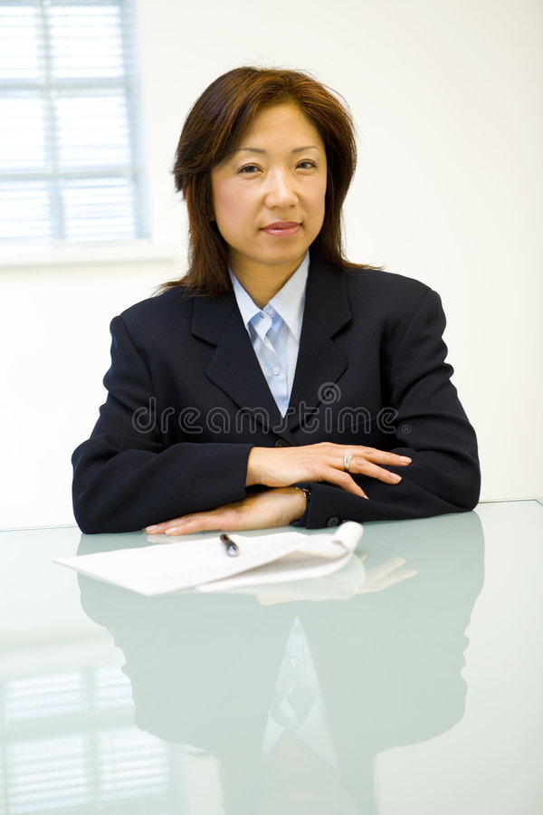 Asian businesswoman at table royalty free stock images