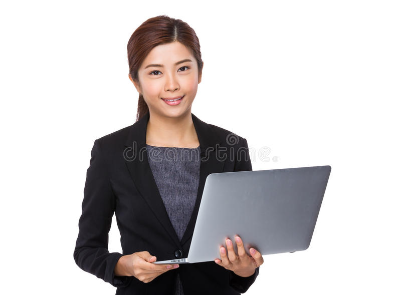 Asian Businesswoman use of the notebook computer. Isolated on white background royalty free stock photo
