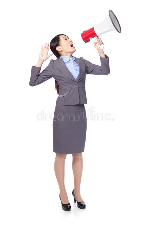 Asian businesswoman using bullhorn. Asian businesswoman using megaphone with energetic face stock image