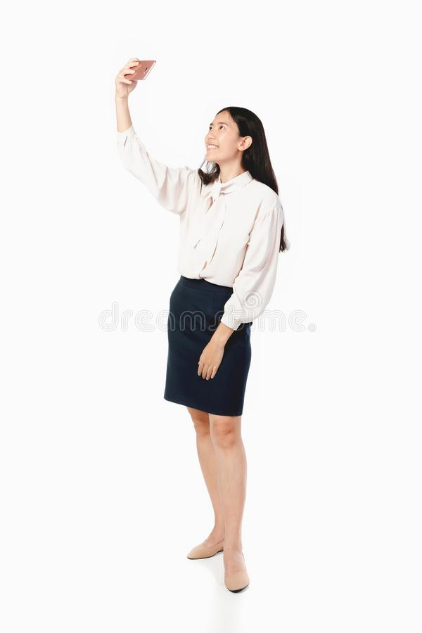 Asian businesswoman using mobile phone over white royalty free stock photography