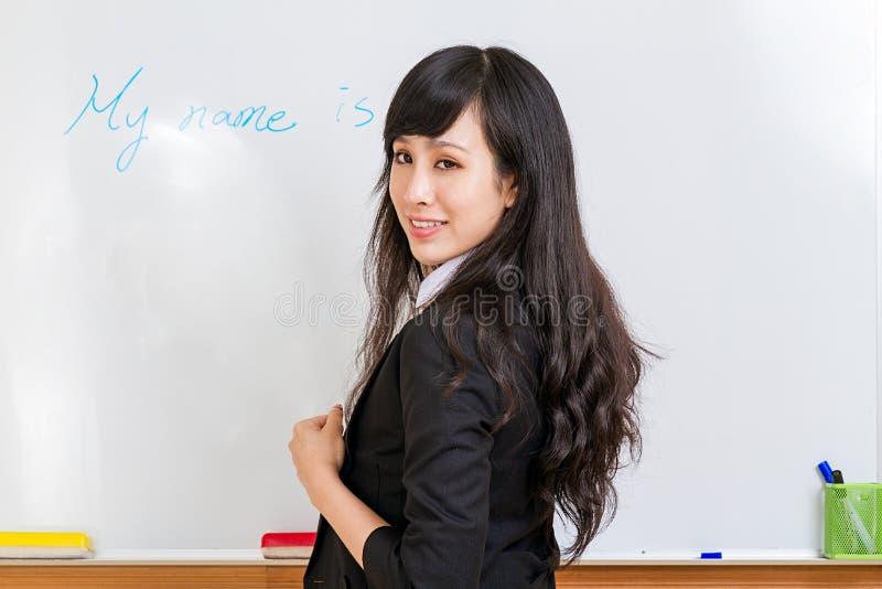 Asian businesswoman at whiteboard stock photos