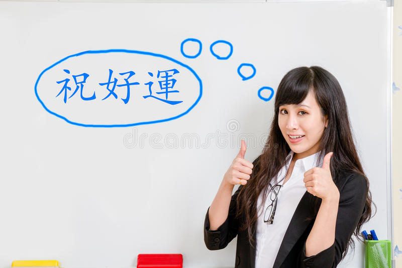 Asian businesswoman at whiteboard royalty free stock photos