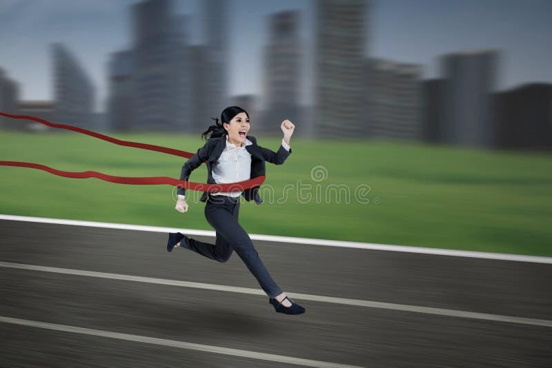 Asian businesswoman winning the race