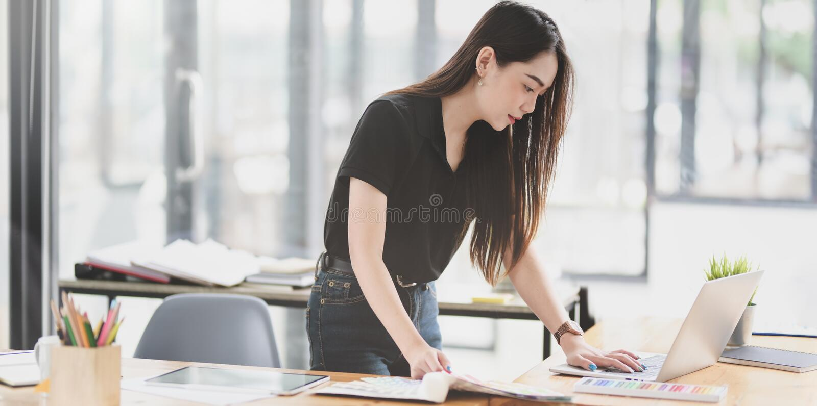 Asian businesswoman working on the project with laptop royalty free stock photo