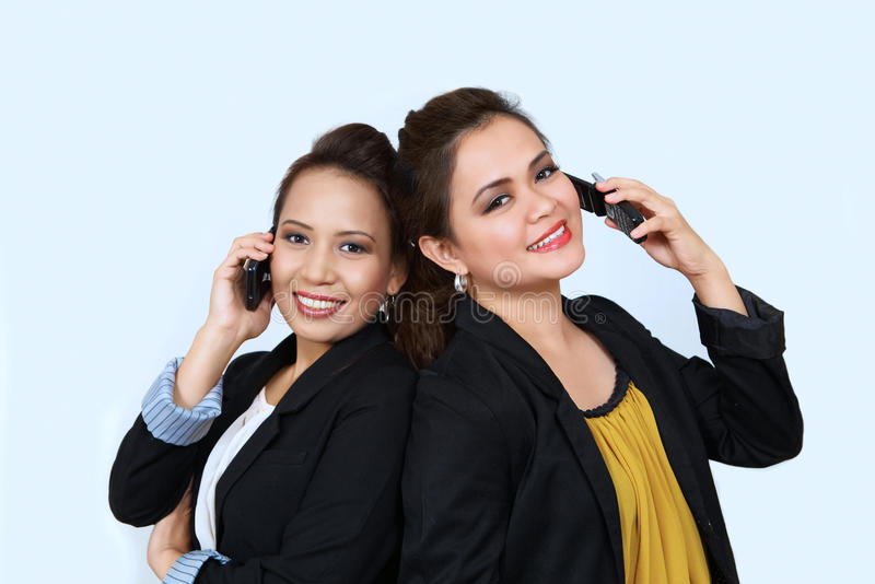 Download Asian Businesswomen On Cell Phones Stock Image - Image of competent, amused: 21950831