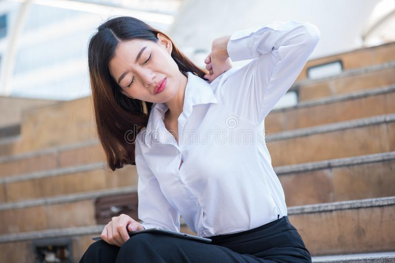 Asian Businesswomen lazy and tried. After finish work. Need to ralax and exercise royalty free stock image