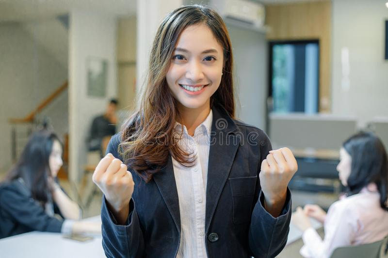 Asian  businesswomen Success and winning concept - happy team with raised up hands celebrating the breakthrough and achievements.  royalty free stock images