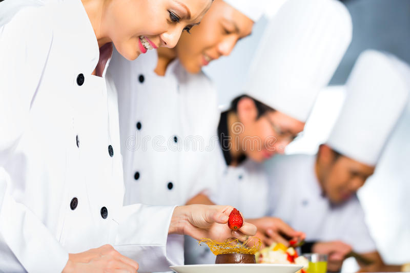 Download Asian Chefs In Restaurant Kitchen Cooking Stock Image - Image of indonesia, preparing: 36509823